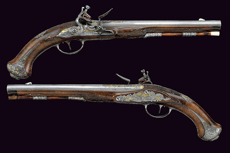 An outstanding pair of flintlock pistols