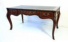 Louis XV Style Bureau Plat. Parquetry leather top