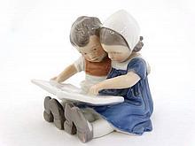 A Royal Copenhagen porcelain figure group.  '' Reading Children '