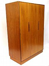 Vintage Retro : an English G - Plan (red) ' double ' wardrobe ( has three doors, two folding ) opening to reveal fully open hanging space , 48