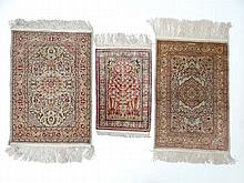 Carpet / Rugs: a collection of 3 assorted small rugs ( prayer mats?) , a hand woven Silk with rose and crescent moon in the borders around a central image of a medallion with fruit and flowers , 37