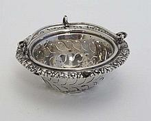 A Continental silver tea strainer of basket form with swing handle