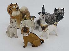 A collection of seven assorted ceramic dogs. To include A Royal Doulton Cairn terrier HN 1033. A ceramic Parson Russell Terrier impressed mark 9539 to base. Another similar terrier indistinctly marked to base. A large ceramic Chow, not marked. A 19th