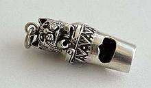 A small silver whistle with cat head decoration. Marked ' Sterling '  1 5/8