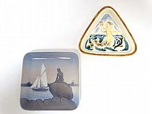 Two items of Royal Copenhagen wares depicting mermaids comprising a triangular dish in high relief by Knud Kyhn depicting a merboy c1930, together with a square shaped dish depicting Hans Christian Anderson's 'Little Mermaid' in Copenhagen. Printed
