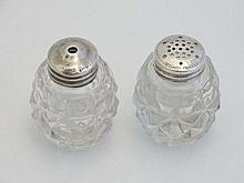 A glass and silver salt and pepper cruet set, the glass pots with Sterling Silver tops. Each approx 2