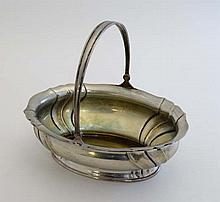 Continental white metal : A German .800 silver  basket of ovoid form with sing handle and traces of gilding. Marked 800 and mark for Gebruder Kuhn - Schwabisch Gmund . c1900. 6 1/2