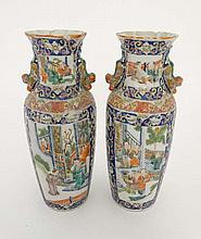 A pair of  hand painted Chinese, Famille-Rose vases . Probably Cantonese. Decorated with scenes of Oriental figures. Possibly late 18th century . 5'' high x 4'' diameter.
