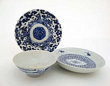 3 Chinese blue and white ceramics : A provincial 19thC saucer dish with bat decoration to inner edges; a provincial 18th / 19thC bowl decorated to exterior with a pair of phoenix; an early 20thC plate with a bird in the centre and figures surrounding
