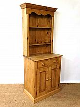 An unusual contemporary narrow stripped pine dresser with open plate rack on a 2 drawer base with 2 cupboards . 28 1/2