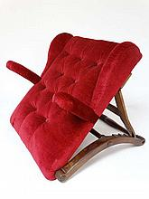 A Victorian mahogany and oak button back red velvet upholstered adjustable bed rest with short open arms . Approx 23 1/2