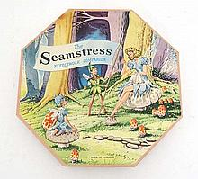 Toy: 'The Seamstress' needlework companion. A 1960's child's boxed sewing kit. With threads and needles.
