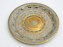 A brass dish with central emblem for Ceylon / Sri Lanka Girl Guides Association ( 1917-1967)    and having embossed decoration of various native animals and birds.  7 3/4