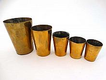 5 Geo V brass pub measures from 1/4 gil to half pint (5) Tallest 3 7/8