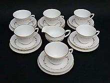 A Royal Worcester '' Gold Chantilly '' tea set. Comprising 6 cups (2 3/4'' high) , 6 saucers (5 3/4'' diameter) and a milk jug (3'' high). (13)