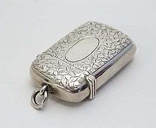 A silver vesta with engraved floral decoration hinged lid and striker under . Hallmarked Chester 1898 maker John Millard Banks 2