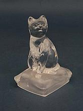 Glass : a clear Art glass sculptural paperweight  in the form of a cat seated sejant upon a cushion , the underside of the cushion frosted. 5