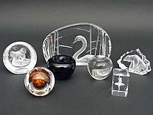 Art Glass including works by Mats Jonasson of Sweden : 7 various items of Art Glass to include a pen stand / paperweight of clear glass with amber centre by Kosta and signed under ' Kosta 95190 Morales ' 2