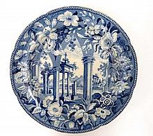 An early 19th C blue and white transfer printed plate by Rogers decorated in Tivoli pattern. Diameter 9