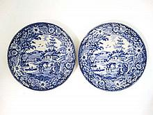 A pair of early 19thC blue and white transfer printed plates decorated in The Native pattern. Unmarked. Diameter 9 1/2