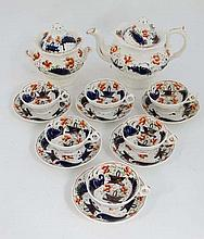 A 19th century tea set Comprising tea pot, sugar bowl, six cups and six saucers decorated in stylizes Imari palette. With floral , basket and scroll decoration with gilt highlights. Unmarked.  Teapot 8'' high. Cups 2 3/4'' high. Saucer 5 3/4''.