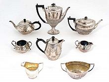 Two 4-piece silver plate tea sets, one with engraved decoration the other fluted decoration.