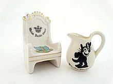 Two Crested china Items. To include a Victoria China model of a Welsh Bardic chair. 3 1/2'' high. Together with a Wilton China jug showing '' Felix the cat ''. 2 1/2'' high (2)