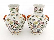 A pair of Chinese Famille-Rose porcelain vases, with Joaiqing mark to base. Painted with butterflies with floral details. 13'' high