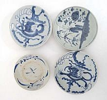 A collection of 4 blue and white Chinese plates comprising 2 plates depicting 5-toed dragons, one with stylised flowers and another with stylised trees and flowers. Indistinct marks to base. Diameters 6