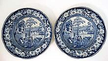 A pair of early 19thC blue and white transfer printed plates decorated in The Philosopher pattern. Indistinct mark to base. Diameter 10