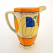 A Clarice Cliff octagonal shaped jug decorated in Melon pattern from Fantasque in the Bizarre Range, decorated with a wide band of melons within orange and black borders. 1929-30. Height 8