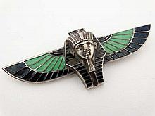 Egyptian Revival : A white metal brooch formed as a Pharaoh and wings with enamel decoration 3