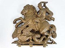 A Victorian cast brass Armorial crest depicting George and the Dragon 14 1/2