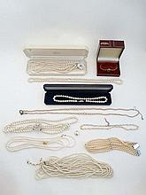 A quantity of assorted costume jewellery to include assorted pearl necklaces and a wristwatch
