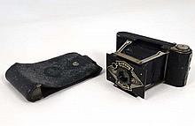 A cased ' Ensign Midget ' camera by Houghton - Butcher Mfg Co Ltd, London E17 . 3 1/2