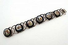 Grand Tour Jewellery : A Continental silver / silver gilt bracelet set with 6 micro mosaic ovals depicting various Grand Tour classical sites. Bears indistinct Continental marks approx 6 /2