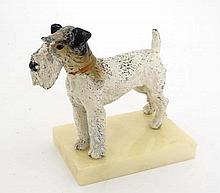 An Art Deco polychorme painted spelter Fox terrier dog upon an onyx plinth 6