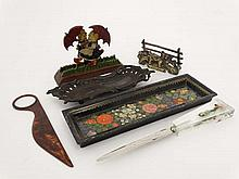 A 1930's letter rack in the form of painted wooden figures together with a brass example, a 1960's Carfloate perspex handled paper knife, a Butterfields of Shipley paper knife and magnifier , a Rococo pierced pen tray and an Indian pen tray ( 6