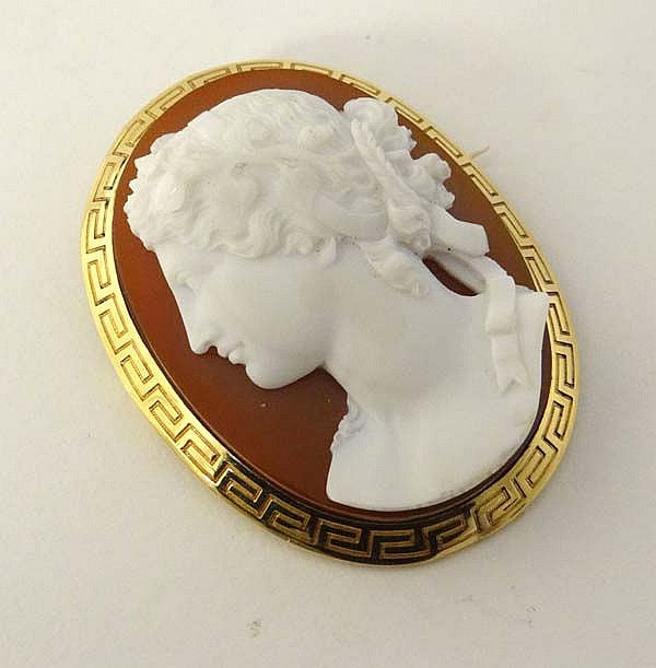 A large cameo hardstone brooch depicting classical