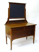 An Edwardian mahogany dressing table with square