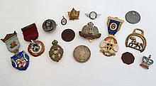 A collection of military and Masonic badges and