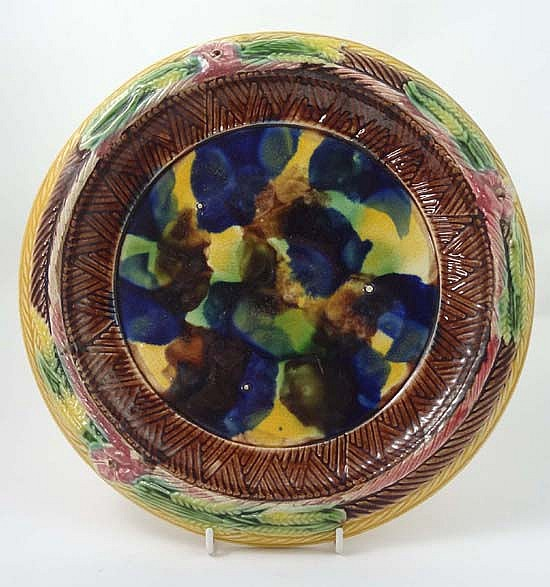 A 19thC Majolica bread plate decorated in mottled