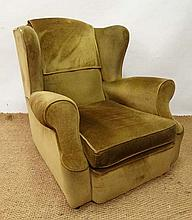 An early - mid 20thC wingback upholstered armchair