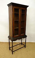 A 19thC oak 2-door glazed cabinet on stand with