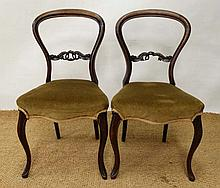 A pair of French mahogany overstuffed boudoir