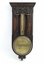 An early 20thC oak cased barometer marked Scot 180