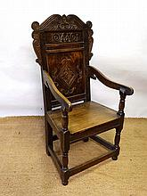 An early 18thC oak Wainscot chair with open arms,