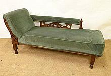 A c.1900 oak chaise longue (right to left) with