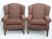 A pair of late 20thC upholstered wingback chairs