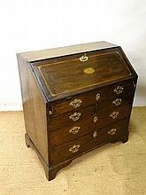 A mid 18thC oak inlaid bureau with fleur de lys